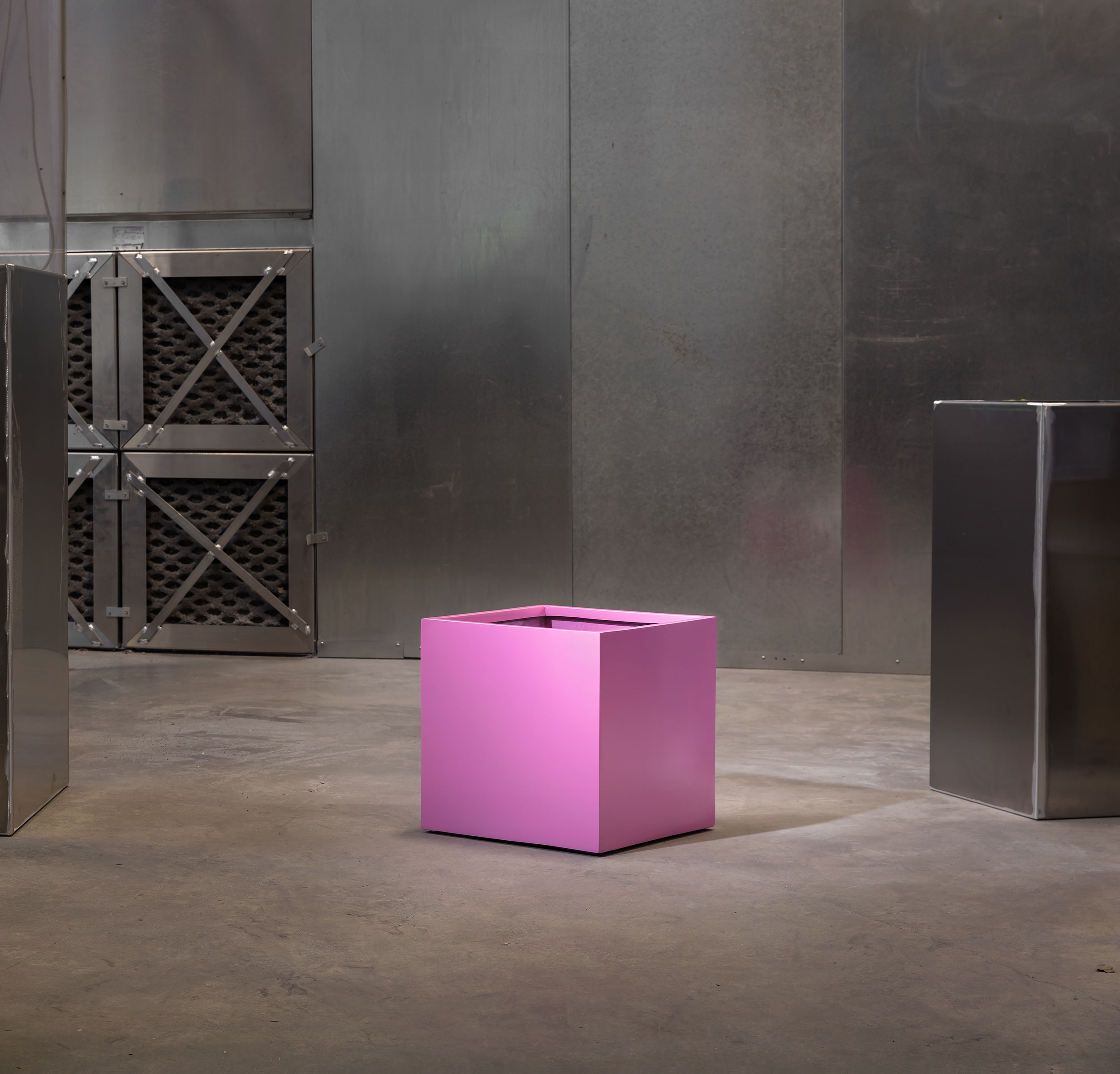 Pink planter designed by Green Theory in their warehouse facility.